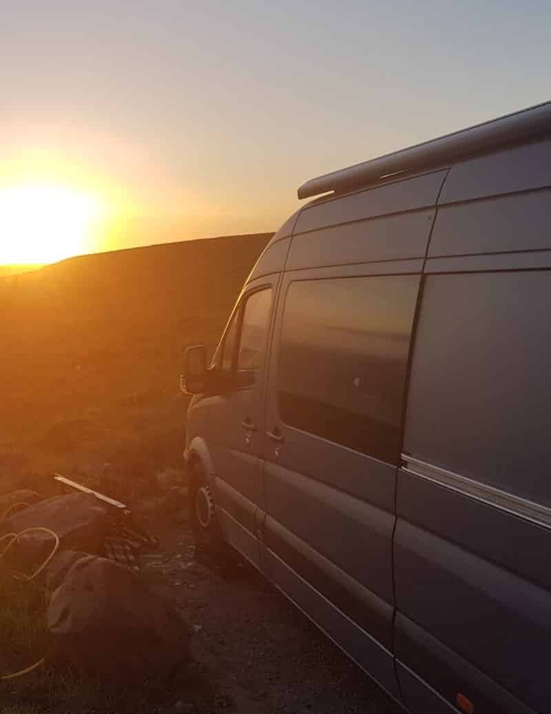 Sunset camping in a Mercedes Sprinter